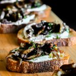 Seared Mushroom Crostini on a board ready for sharing.