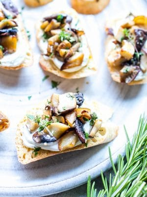 Mushroom Crostini with Whipped Goat Cheese on a plate.