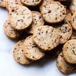 Cocoa Nib Pecan Shortbread Cookies on a marble slab ready to eat.