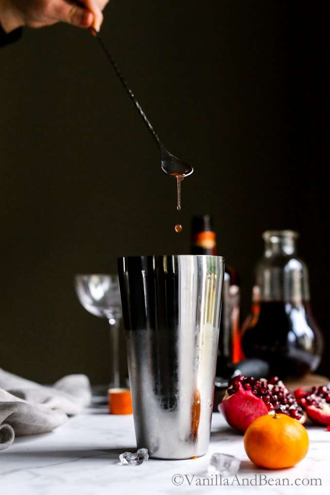 A pear and orange liqueur, pomegranate and orange juice cocktail. Winter Punch. | Recipe, Holiday, Drink