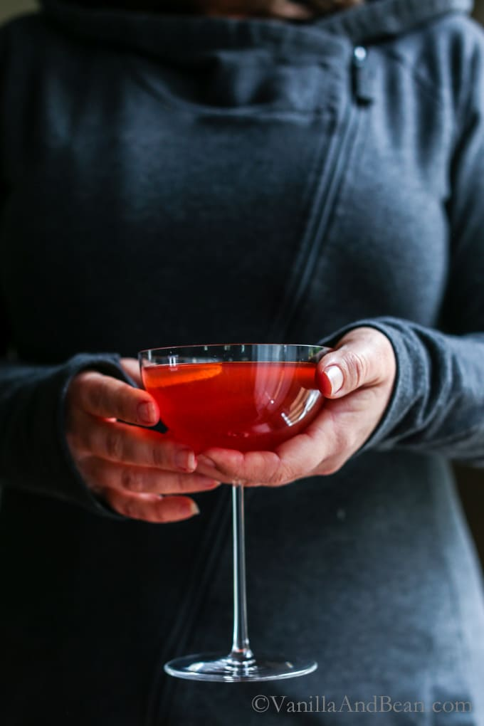 A pear and orange liquor, pomegranate and orange juice cocktail. Winter Punch. | Recipe, Holiday, Drink