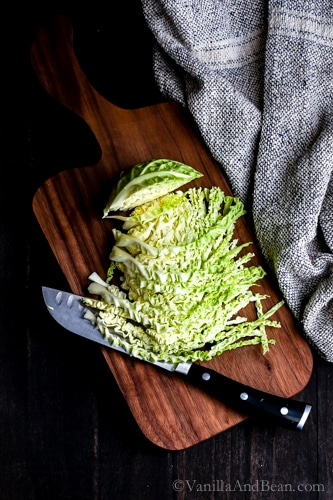 Chopping cabbage on a cutting board.