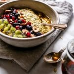 Overnight Turmeric Chia Oats in a bowl with a spoon ready for sharing.