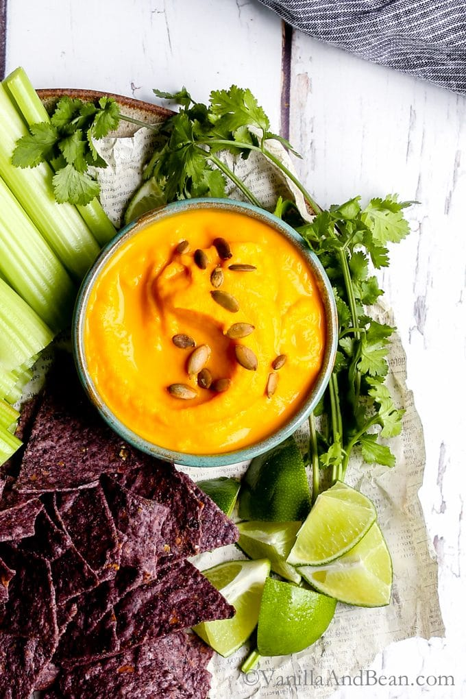 Roasted Habanero Carrot Salsa shared with celery, chips, cilantro and lime ready for sharing.