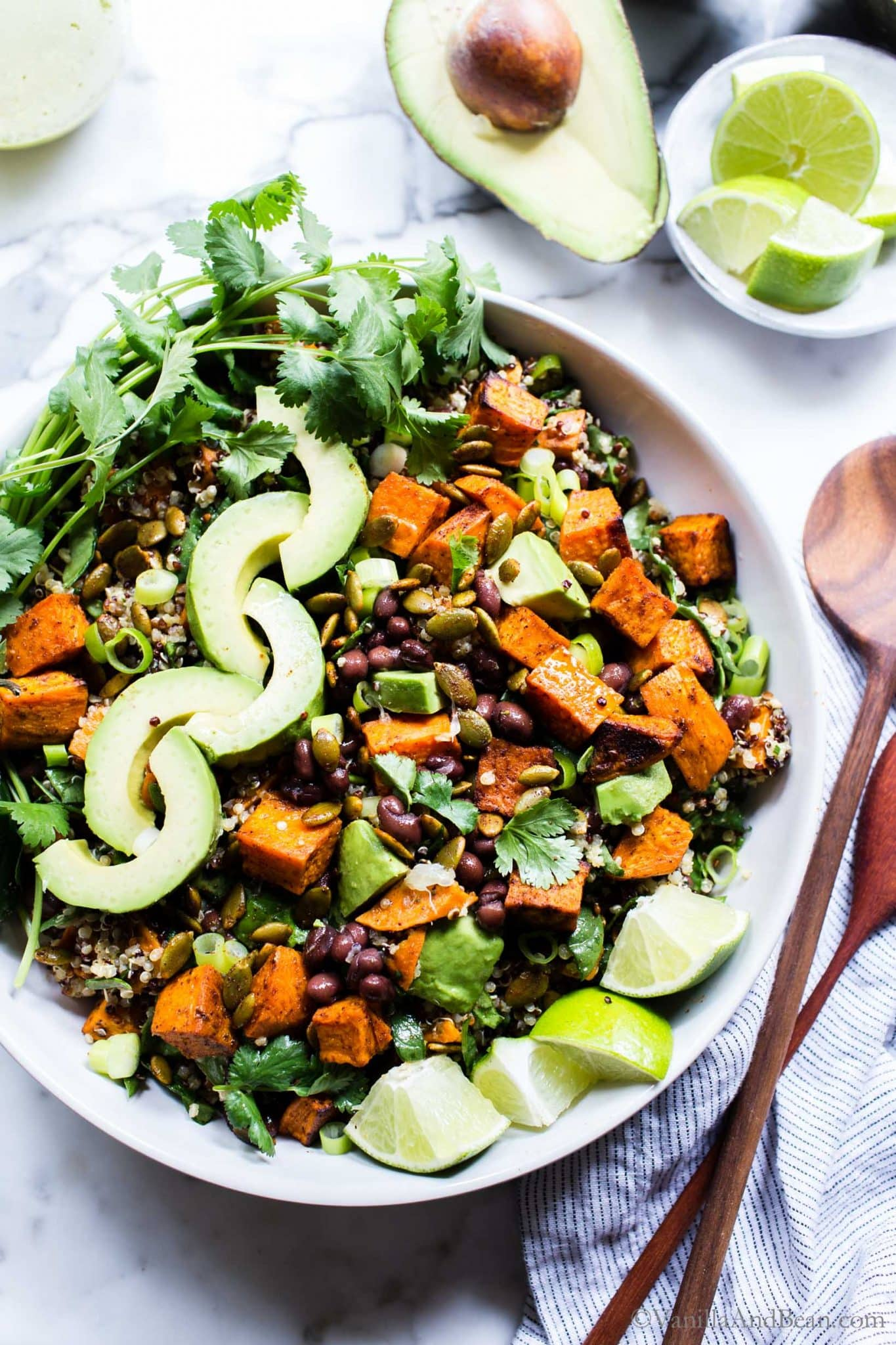 Sweet Potato Quinoa Salad in a bowl with spoons on the side ready to eat.