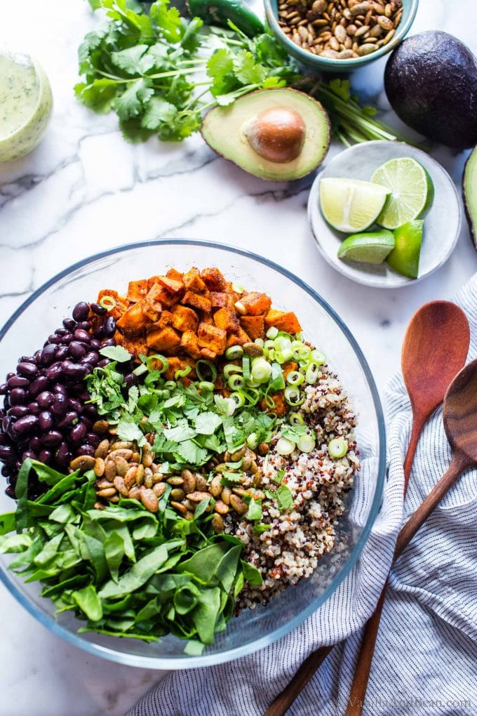 Quinoa Sweet Potato salad with black beans in a bowl before being tossed.