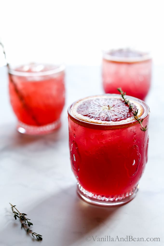 Bubbly, citrusy, refreshing with notes of raspberry and cucumber, Blood Orange Gin and Thyme Cocktail embraces winter's freshest of fruits. | Cocktail Recipe