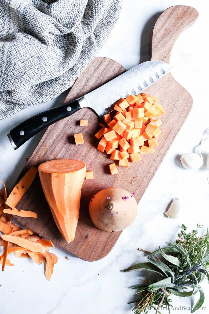 Cutting Sweet Potato on a Cutting Board