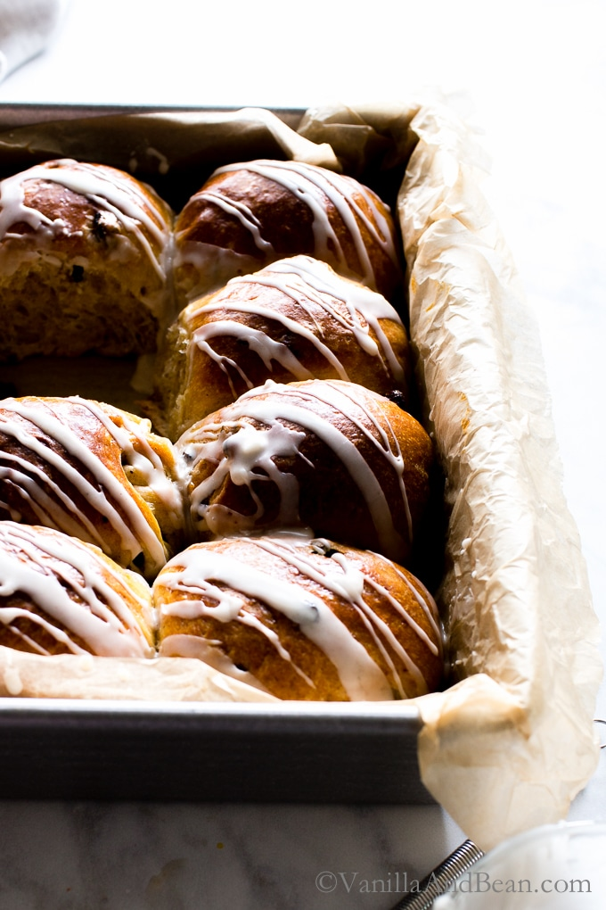Hot Cross Buns with Rum Soaked Currants drizzled with glaze.