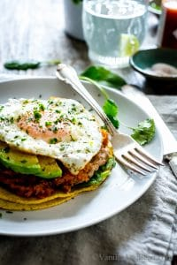 Sweet Potato Pinto Bean Open-Face Breakfast Tacos on a plate with a fork ready to eat.