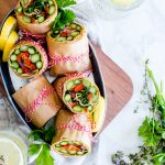 Asparagus Wraps with Whipped Avocado Sun-Dried Tomato Spread in a serving tin.