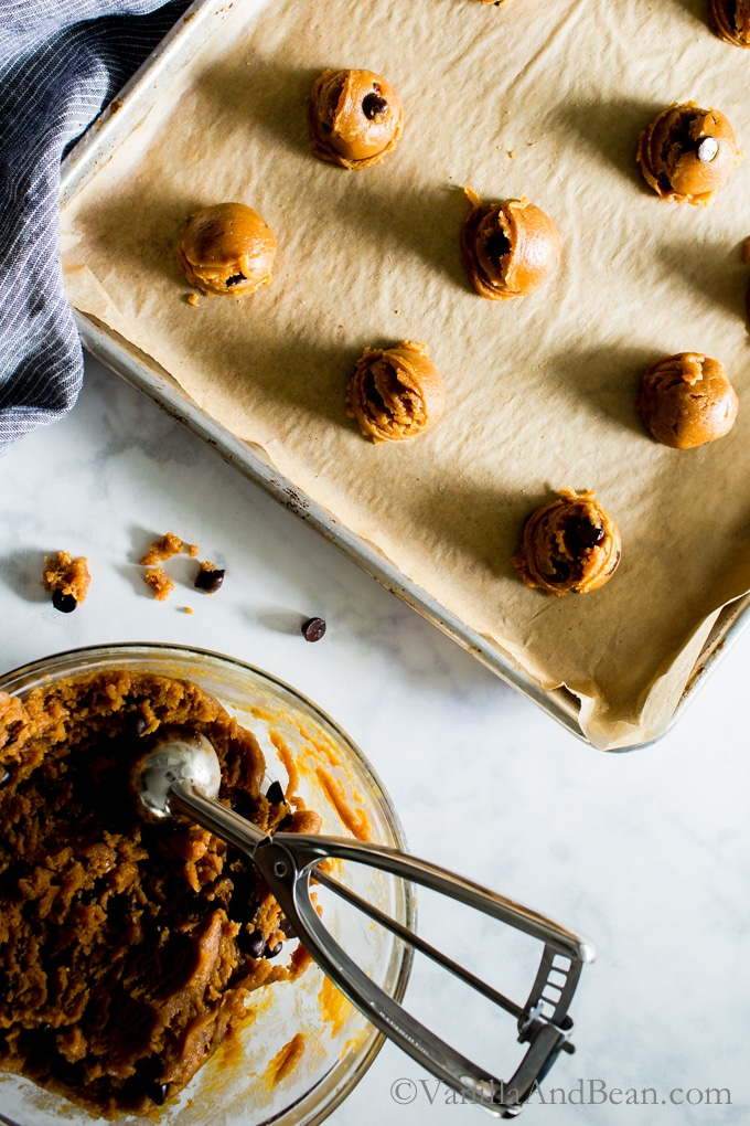 Scooping the Flourless Peanut Butter Chocolate Chip Cookies from Kathryne Taylor's new cookbook Love Real Food have a whole jar of peanut butter in there! Tender, rich and oh SO peanut-buttery! Gluten-Free | Grain Free | Recipe | Cookies |