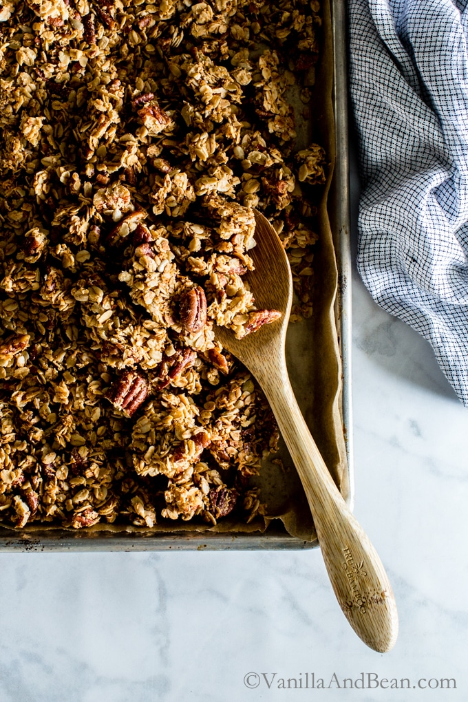 Maple Pecan Granola in a sheet pan ready to be shared.