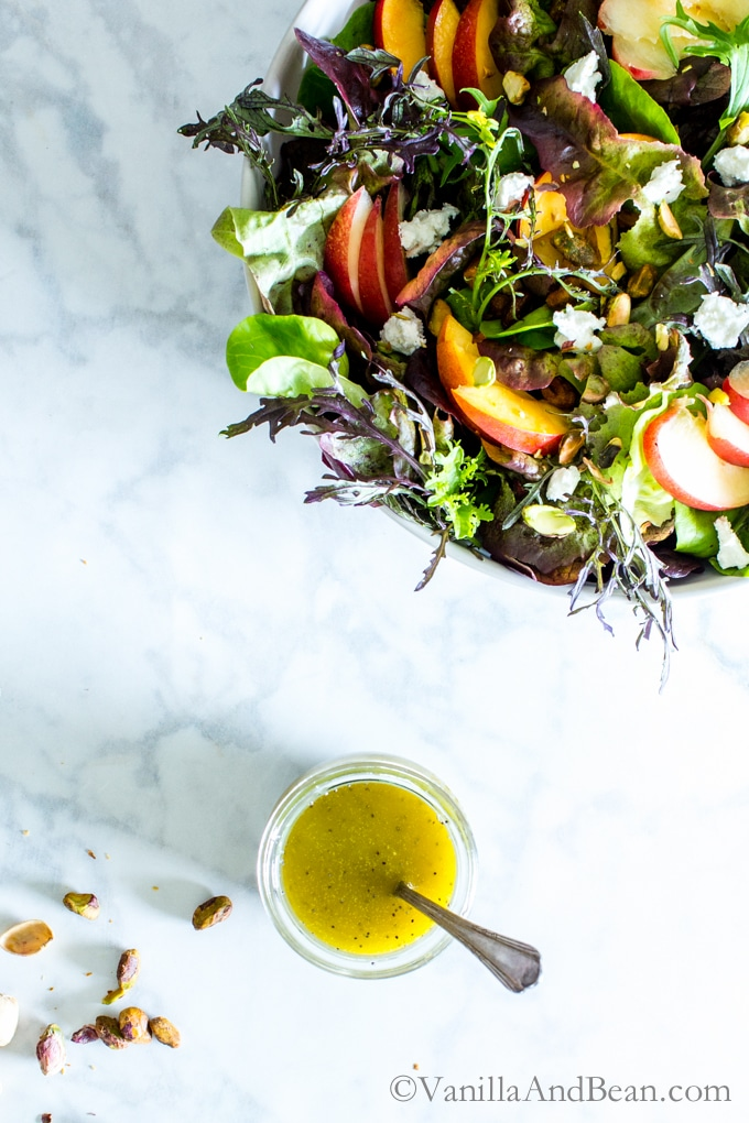 Use the freshest farmers market summer greens in this simple salad: Nectarine, Pistachio and Goat Cheese Salad with Honey Dijon Vinaigrette. Vegetarian + Gluten Free