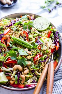 Sesame Noodle Salad in a bowl with serving spoons on the side.