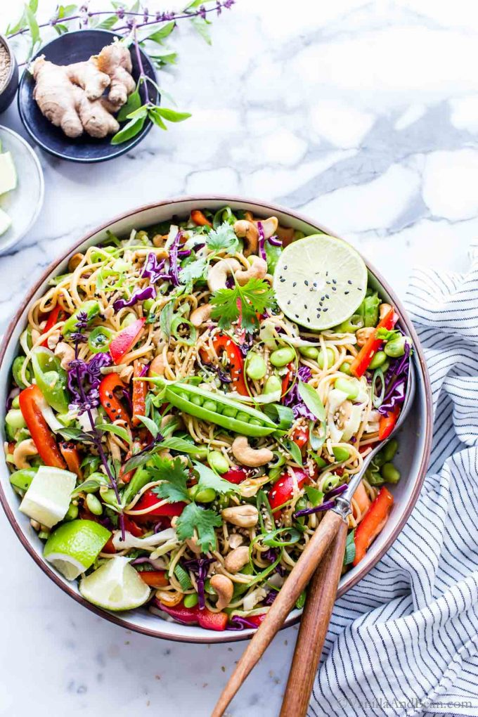 Cold Noodle Salad in a bowl ready for sharing with a pair of serving spoons in the bowl.