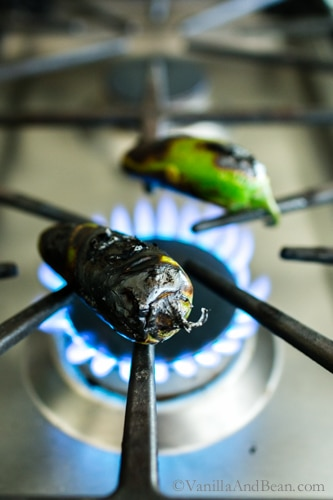 Charring jalapenos on an open flame, stove top.