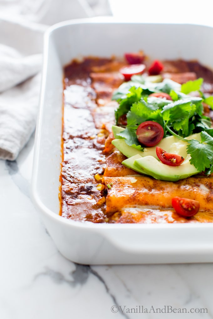 Sheets (yes sheets!) of sweet potato envelop black beans, corn, spices and jalapeño jack in these Sweet Potato Wrapped Black Bean Enchiladas! vegetarian | gluten free |