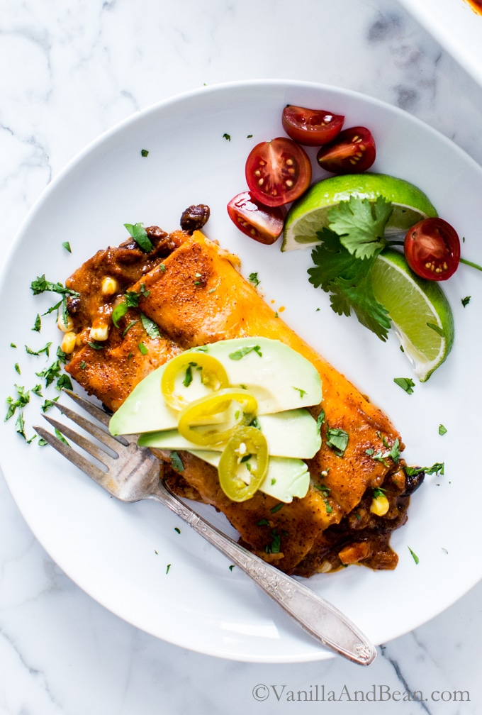 Sheets (!!) of sweet potato envelop black beans, corn, spices and jalapeño jack in these Sweet Potato Wrapped Black Bean Enchiladas! vegetarian | gluten free |