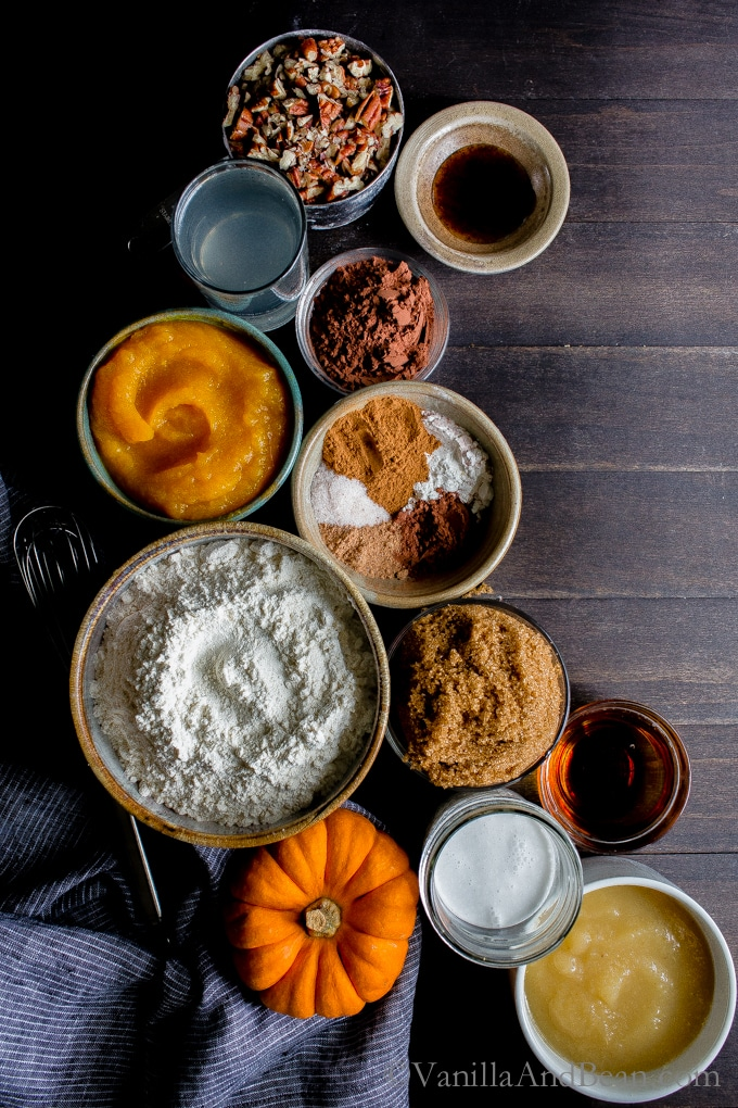 Overhead shot of ingredients for Pumpkin Pecan Bundt Cake .