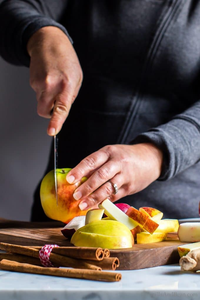 Slicing apples on a cutting board.