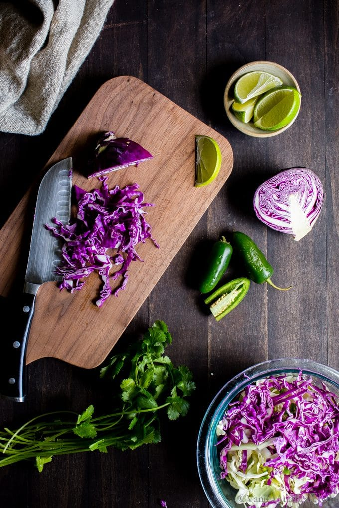 Chopping red cabbage on a cutting board.