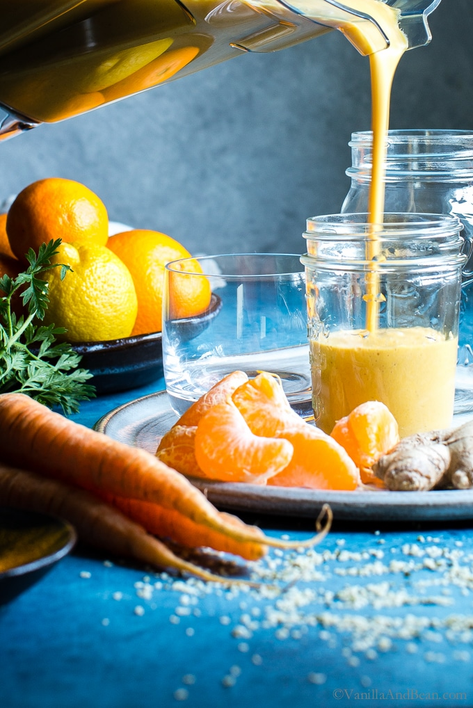 For the coldest months of the year, add a little sunshine to your routine with a Carrot-Ginger Citrus Immune Boosting Smoothie. It comes together fast and is an easy way to start the day on a healthy note. #Vegan #GlutenFree #Smoothie #Vitamix