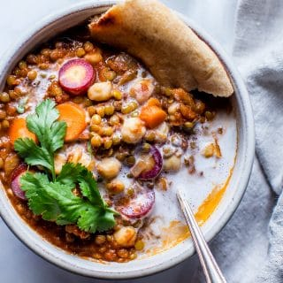 Simple ingredients, and texture rich with mouthwatering flavors; Moroccan Lentil Chickpea Stew comes together in about 45 minutes. With a dollop of coconut cream, a sprinkle of cilantro and flatbread, dinner is ready! vegan + gluten free