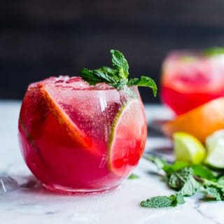 Enjoy a little citrus zing with a minty classic mojito: Blood Orange Mojitos brighten up this classic cocktail during the coldest days of the year. Refreshing and simple to make. #HappyHour #FoodPhotography #Recipe #Cocktail #Bloodorange