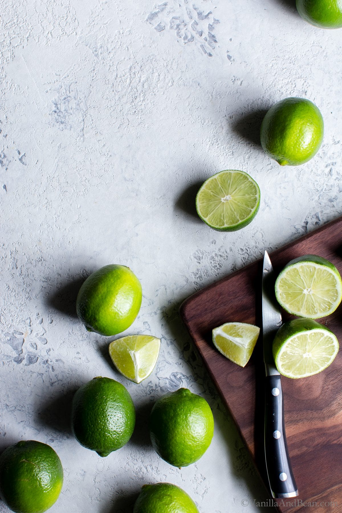 Chopping limes for Margaritas.