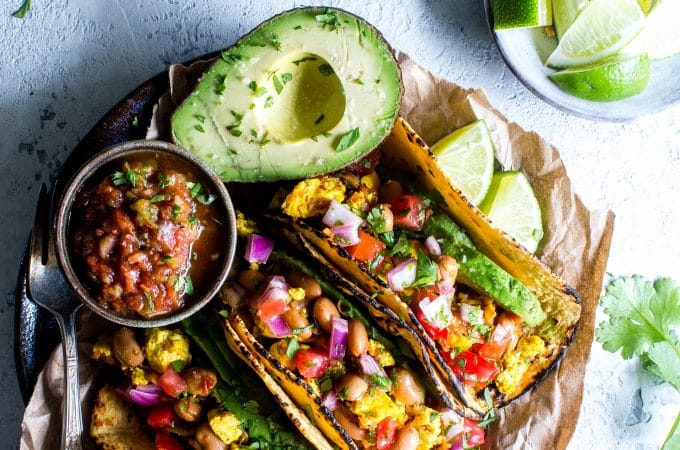 Rancheros Tofu Scramble has all the flavor and texture as scrambled huavos rancheros, but without eggs. Even egg lovers rave about this recipe! Meal prep ready! vegan + gluten free option