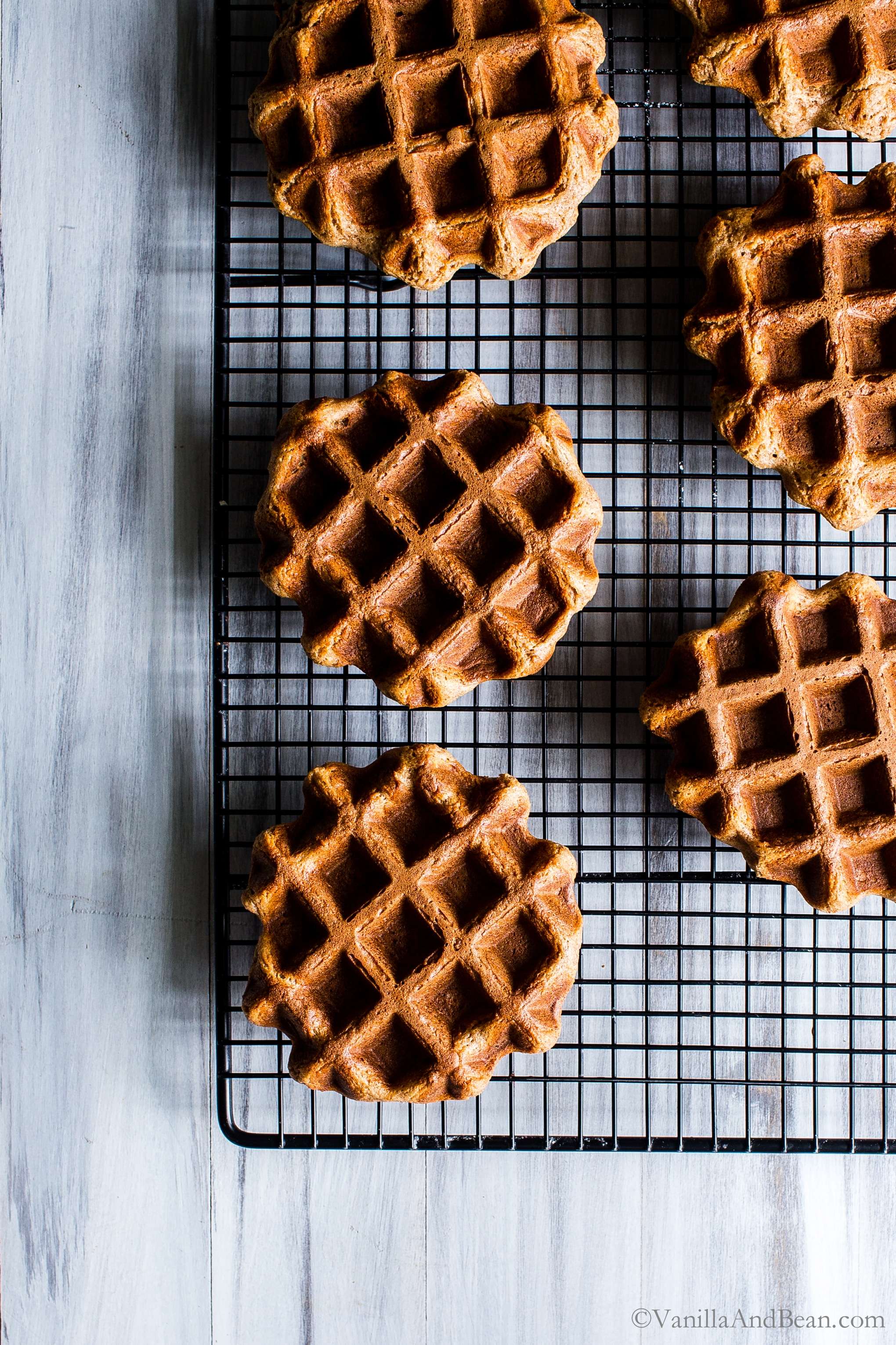 Overhead shot of baked waffles on a cooling rack.