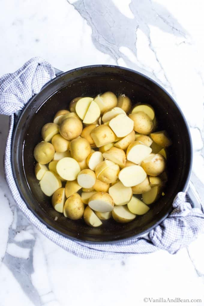 Yukon Gold Potatoes in a Dutch oven covered with water.