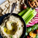 Roasted Eggplant Artichoke White Bean Dip is simple to whip up and is freezer friendly. Pair it with your favorite wine, crostini, crackers and veggies for a most satisfying snack! #Plantbased #GlutenFree #Dip #Spread #Crostini #Appetizer #Eggplant