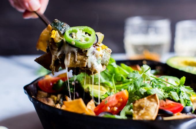 Weeknight Skillet Black Bean Vegetarian Enchiladas Verde are packed with late summer veggies, flavor, texture and pepper jack cheese. Cooking in one pan makes clean-up a snap! #vegetarian #glutenfree #VegetarianEnchiladas #EnchladasVerde #TomatilloSalsaVerde