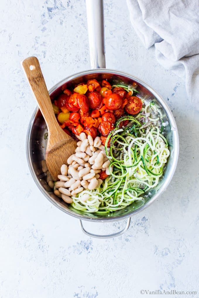 Zucchini Noodles (Zoodles) with Roasted Cherry Tomatoes recipe: quick to pull together and packed with late summer veggies. I share how simple it is to cook zucchini noodles in a fabulous and easy zoodles recipe. A healthy pasta alternative when zucchini is in season! #VegetarianFood #VeganFood #Recipe #Zoodles #ZucchiniNoodles