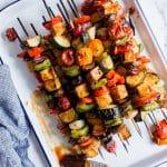 Overhead shot of BBQ Tofu Vegetable Kebabs on skewers.