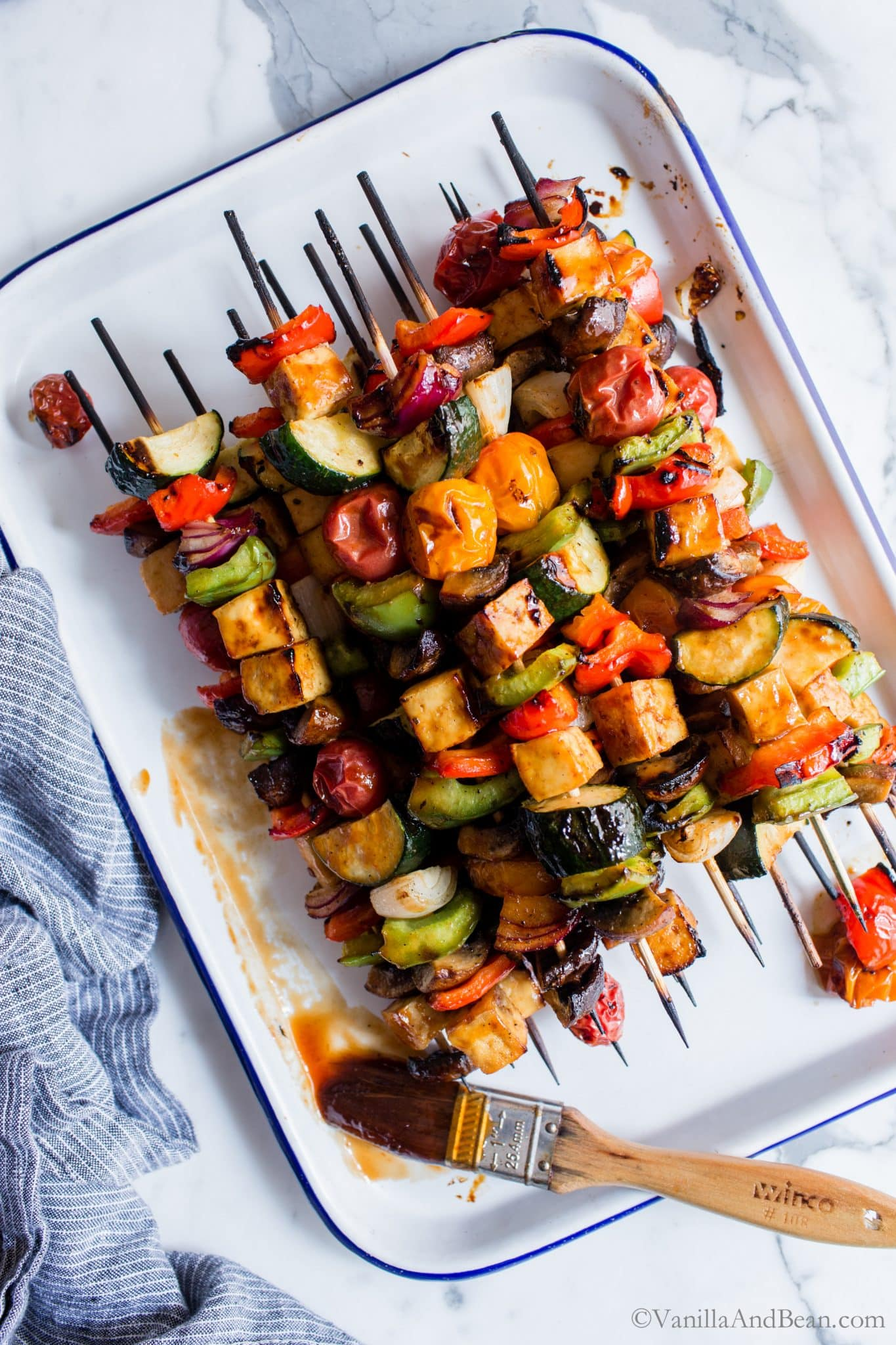 Saucy, tangy and so flavorful Grilled BBQ Tofu Vegetable Kebabs are simple to make and packed with late summer favorites! #veganfood #glutenfree #GrilledTofu #GrilledVegetables #BBQ