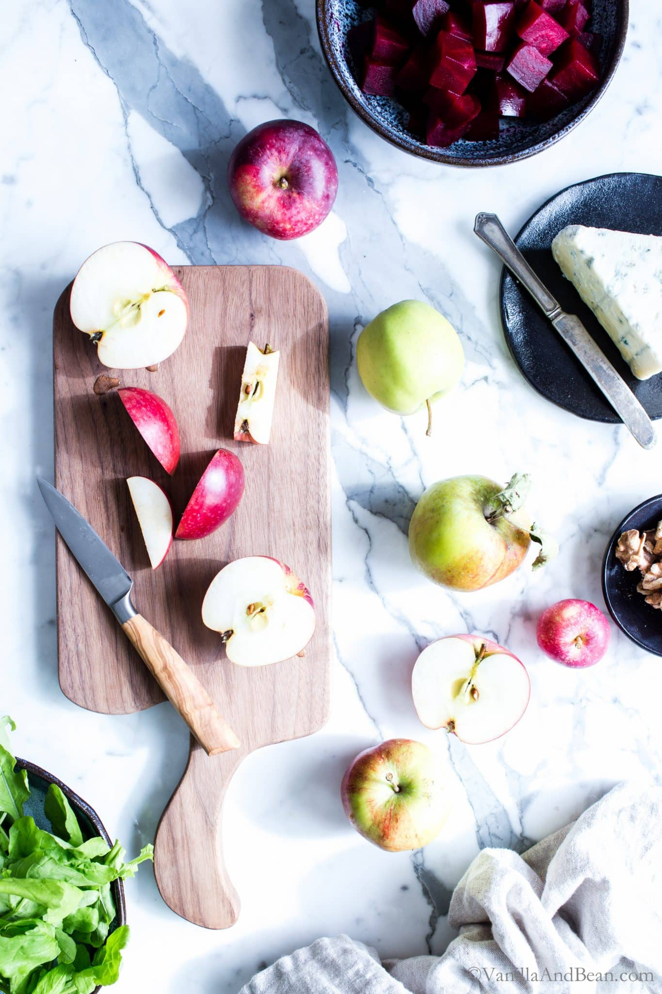 Cutting apples on a cutting board for Beet and Apple Salad with Apple Cider Vinaigrette.