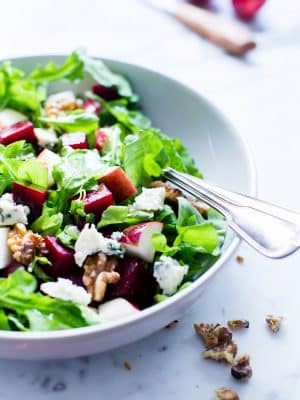 Beet and Apple Salad with Apple Cider Vinaigrette in a serving bowl ready to be shared.