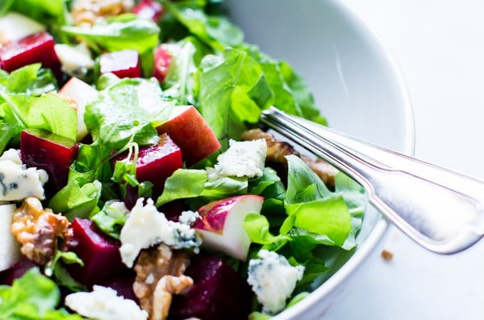Nourishing fall flavors come together in this simple yet flavor packed salad. With a snappy dressing, Roasted Beet and Apple Salad with Apple Cider Vinaigrette is versatile enough to pull together with your favorite greens. | #VegetarianSalad #Vegan Option #GlutenFree