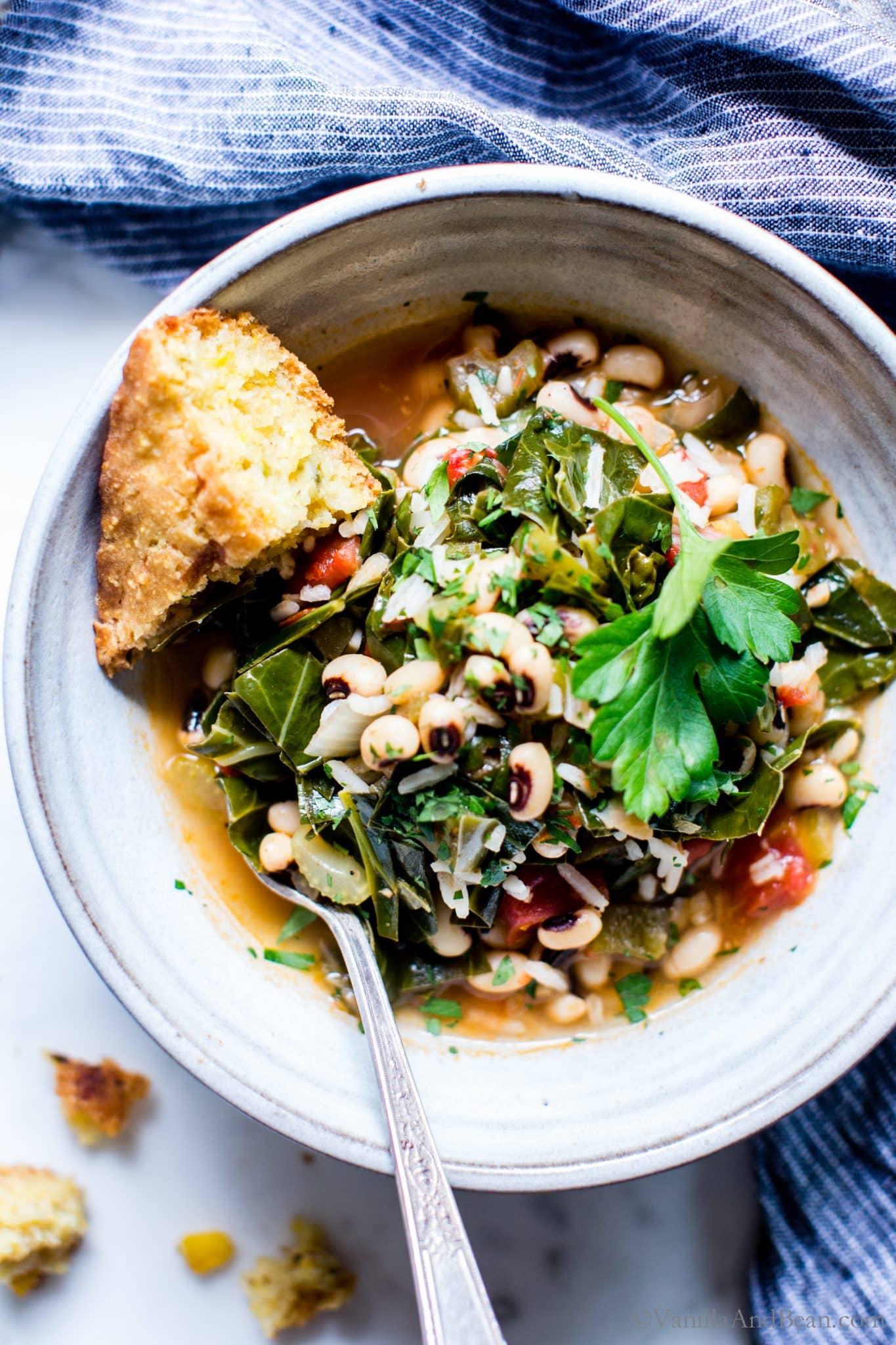 Hoppin John Stew shared with cornbread in a bowl.