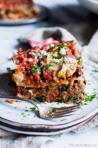 A slice of Spinach-Mushroom Pesto Ricotta Lasagna on a plate.