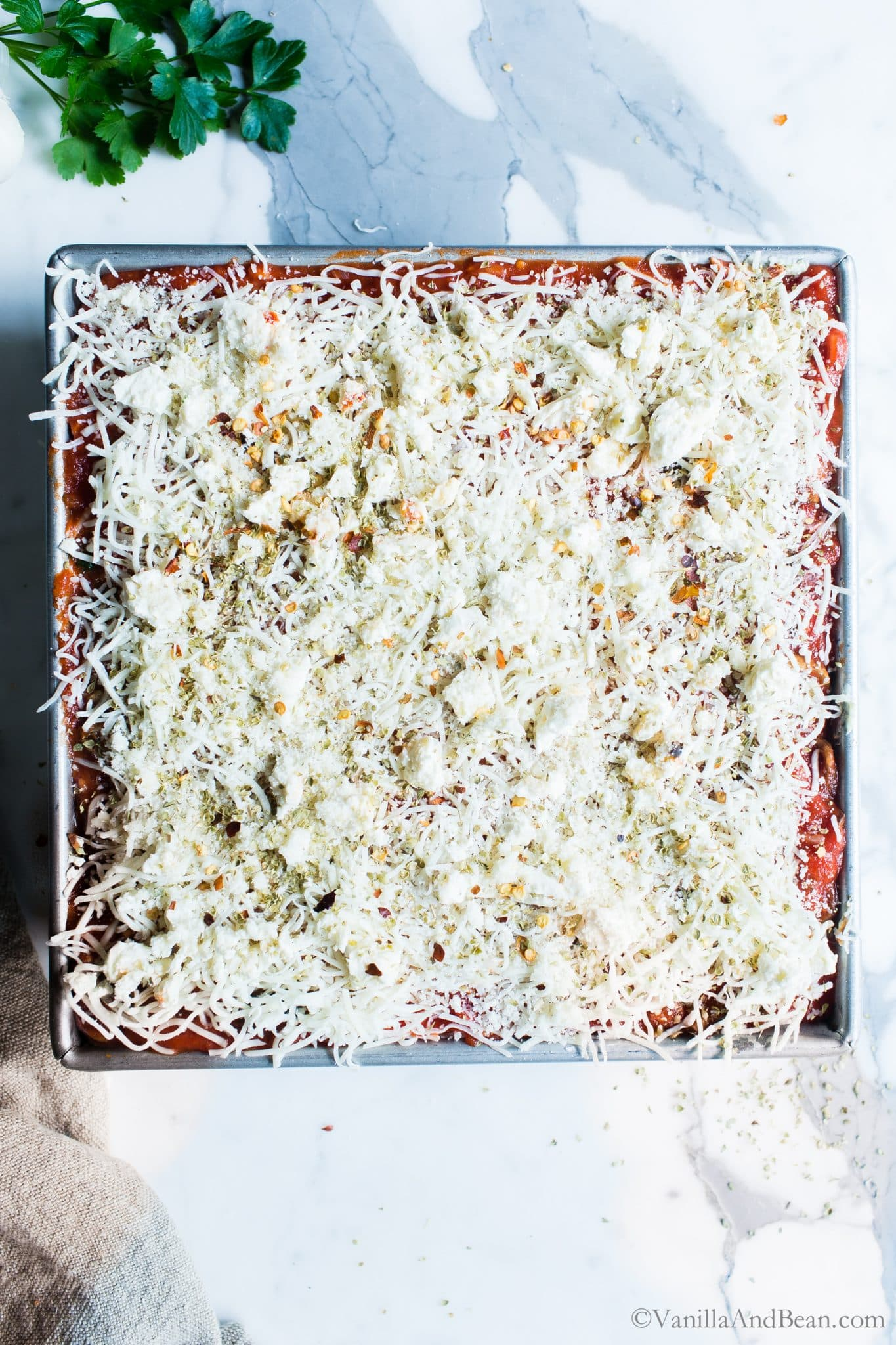Layers of garlicky cheesy goodness in this easier no boil lasagna. Spinach-Mushroom Pesto Ricotta Lasagna can be made ahead, feeds a small crowd and leftovers freeze with ease! #NoBoilLasagna #Vegetarian #GlutenFreeLasagna #Dinner