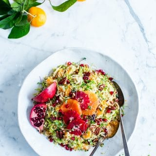 Tangy, juicy, and texture rich, Shaved Brussels Sprouts Citrus Quinoa Salad with a snappy Honey-Orange Dijon Vinaigrette is packed with winter citrus goodness! Perfect for meal prep, lunch and sharing, Shaved Brussels Sprouts Salad is simple to make. #VegetarianLunch #VeganSalad #VeganLunch #GlutenFree #ShavedBrusselsSproutSalad