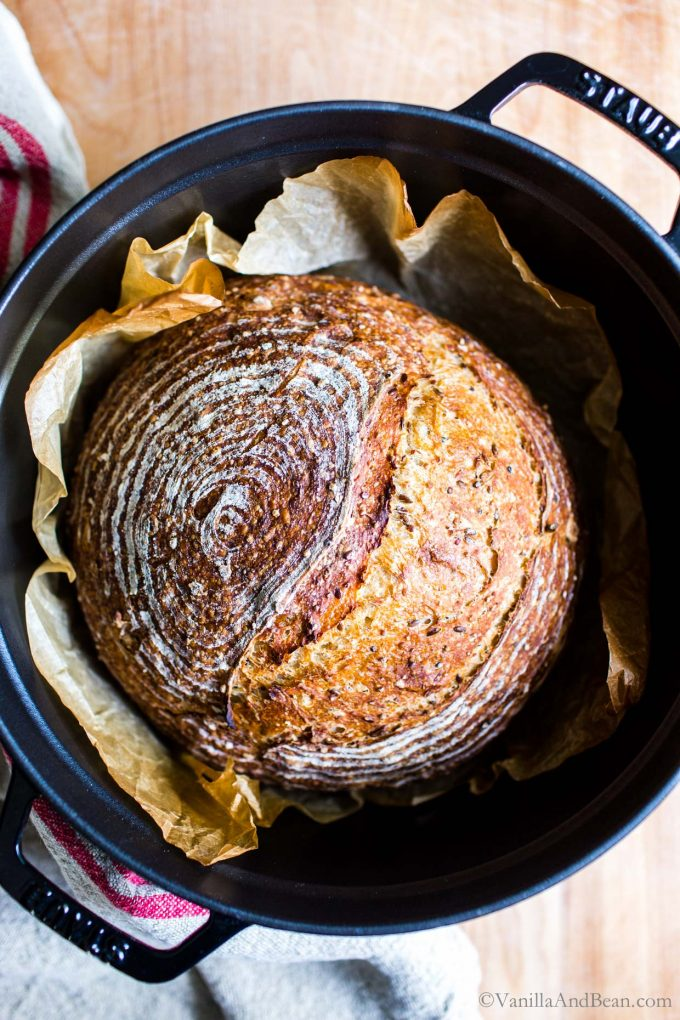 Multigrain Sourdough Bread in a Dutch oven just pulled from the oven.