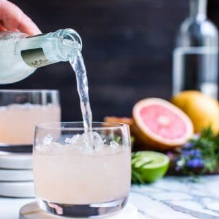 Fresh grapefruit with a hint of rosemary shines in this easy ginger beer and vodka cocktail recipe. With only a few ingredients and a rosemary simple syrup, this grapefruit cocktail recipe is quick to pull together and is so refreshing! #HappyHour #GrapefruitCocktailRecipe #GingerBeerandVodka #VodkaCocktail #Mule