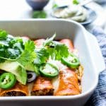 Vegetarian Cheesy Tofu Enchiladas are flavor packed, texture rich and so easy to make! They're freezer friendly and easily gluten free too! #VegetarianEnchiladas #MexicanTofu #Enchiladas #TofuEnchiladas #MeatlessMonday