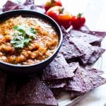 Easy Mexican Chipotle Salsa served with purple chips and cute tomatoes