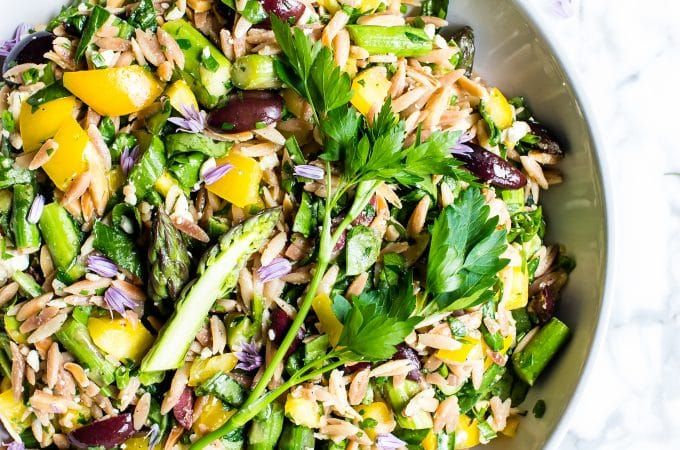 Lemon Orzo Salad with Asparagus, Spinach and Feta in a big bowl ready to be shared.